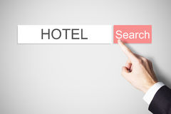 Businessmans finger pressing search button hotel webbrowser Stock Images