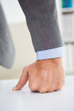 Businessmans fist clenched over desk Royalty Free Stock Photography