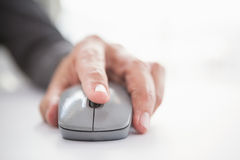 Businessmans hand on computer mouse Royalty Free Stock Photography