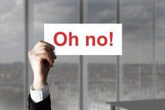 Businessmans-Hand, das kein Zeichen halten oh Stockfoto