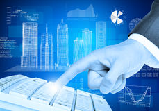 Businessmans hand and graphs Royalty Free Stock Photos