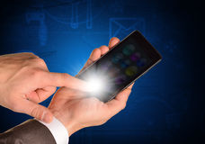 Businessmans hand holding mobile Royalty Free Stock Photography