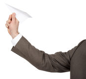 Businessmans hand holding paper plane Royalty Free Stock Image