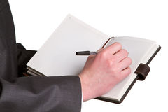 Businessmans hand holding a pen requesting a signature on a docu Stock Images