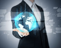 Businessmans hand showing earth globe Stock Photos