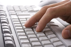 Businessmans hand touching computer keyboard Stock Images