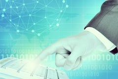 Businessmans hand touching keyboard Stock Photos