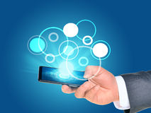 Businessmans hand using smartphone Stock Image