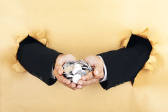 Businessmans hands holding coins Stock Photography