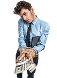 Businessmans hands tied with rope together, modern slavery concept. Photos of young man wearing shirt and tie over white background Royalty Free Stock Image