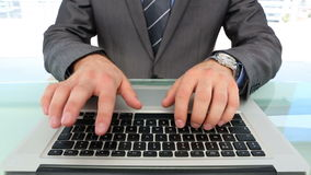 Businessmans hands typing on laptop. In his office stock video footage