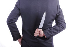 Businessmans holding knife Royalty Free Stock Images
