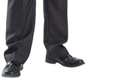 Businessmans legs and dress shoes Stock Photography