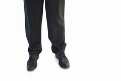 Businessmans legs and dress shoes Royalty Free Stock Image