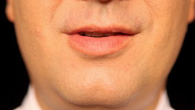 Businessmans mouth talking, extreme close-up Royalty Free Stock Image