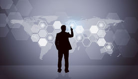 Businessmans silhouette with virtual screen Stock Photos