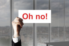 Businessmanshand die teken oh nr steunen Stock Foto