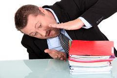 Businessmanwith pile of work Stock Photography