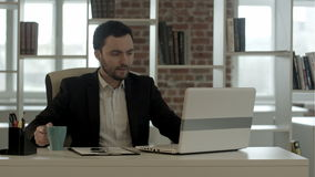 Businessmanworking on his computer in office while stock video footage