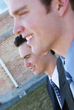 Businessmen. Profile of two businessmen standing in full suits Stock Photography