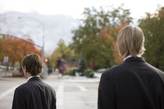 Businessmen. Rear view of two businessmen standing next to street Stock Photography