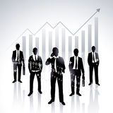 Businessmen. Silhouettes of men in business suits in various poses standing in front of a chart or graph Stock Photos