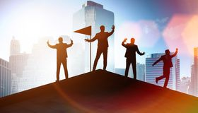 The businessmen in achievement and teamwork concept. Businessmen in achievement and teamwork concept royalty free stock image