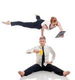 Businessmen - acrobats isolated on white backdrop Stock Photo
