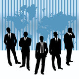 Businessmen against a map of world Stock Photo