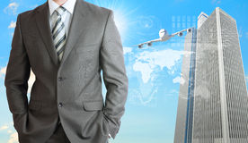 Businessmen with airplane, skyscrapers and world Stock Photo