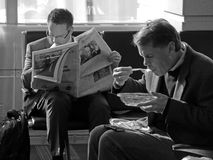 Businessmen in airport lounge while aiting for fllight, horizontal Royalty Free Stock Image