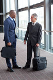 Businessmen at airport Stock Photos