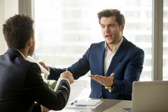 Businessmen arguing at workplace, deal failure, breaking contrac Stock Image