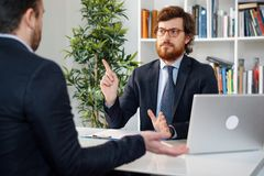 Businessmen arguing at workplace after deal failure and breaking contract royalty free stock photography