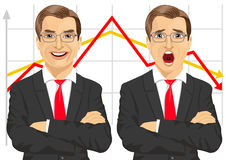 Businessmen with arms folded showing different facial expressions in front of line graphs Stock Photos