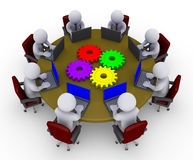 Businessmen around table with laptops and cogs. 3d businessmen around a table with four cogs are looking at laptops Royalty Free Stock Photography