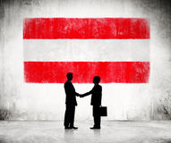 Businessmen with Austrian Flag Stock Photography