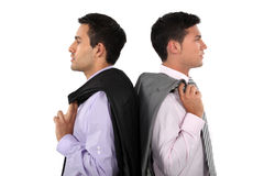 Businessmen back-to-back. With jackets over shoulder Royalty Free Stock Photography