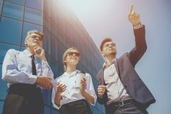 Businessmen on Background of Solar Building. Royalty Free Stock Images