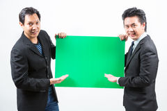Businessmen with banner Royalty Free Stock Photography