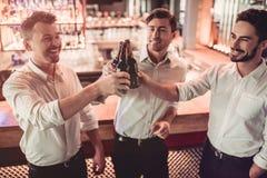 Businessmen in bar stock photo