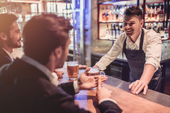 Businessmen in bar royalty free stock image
