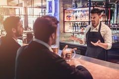 Businessmen in bar royalty free stock photo