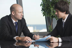 Businessmen bargaining Royalty Free Stock Photography