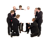 Businessmen with a billboard. Group of businessmen holding a Billboard stock photos
