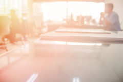 Businessmen blur in the workplace.Table Top And Blur Office of B royalty free stock image