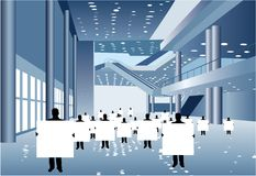 Businessmen with board for text in business center Royalty Free Stock Photo