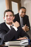 Businessmen in boardroom Stock Images