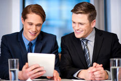 Businessmen browsing on tablet device Stock Photos