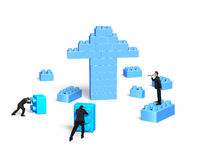 Businessmen building stack blocks in arrow up shape Stock Images